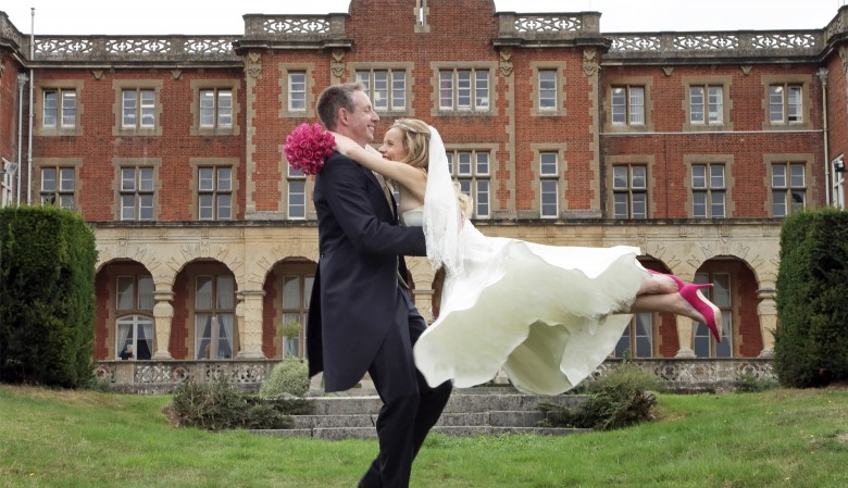 Bride leaping into the grooms arms